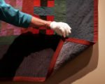 Barbara McIntire (cq), a volunteer docent at the Denver Art Museum, practices the delicate job of...