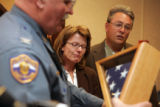 Slain Trooper Zach Templeton's  parents, Teresa and Doug Templeton, fight back tears as Col. Mark...