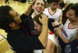 Sam Litvak, left, congratulates Desi Rotenberg, top, and Andy Friednash, bottom, after defeating...
