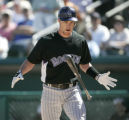 00673 Colorado Rockies' Jayson Nix flips his bat after hitting a foul ball in the second inning as...