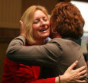 L to R: Rep. Elect Karen Middleton, D-Aurora,  hugs friend Pamela Jo Suckla (cq) after being ...