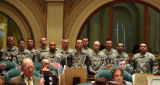 Members of the 2nd Battalion, 12th Infantry Regiment from Fort Carson stand and listen while...