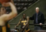 MJM1046  University of Wyoming mens basketball player, Bienvenu Songondo (cq) gets some...
