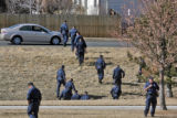 Aurora Police search for  weapons and shell casings in Highland Hollow Park Wednesday afternoon...