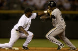 Eddy Garabito (left) second basemen for the Colorado Rockies tags out Chicago White Sox base...