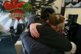"DM0360   David ""Doc"" Anderson, right, gets a hug from Kyle Anderson at the Ink for the..."