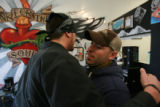 "DM0361   David ""Doc"" Anderson, right, gets a hug from Kyle Anderson at the Ink for the..."