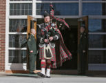 Pikes Peak Highlanders, Peter Harty (cq), plays the Bagpipes, in front of the Soldier's Memorial...