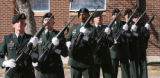 A Honor Guard waits for the Firing of Volleys, outside the Soldier's Memorial Chapel, during a...