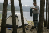 Rick Curlin (cq) from Arvada,CO rigs his fishing pole at his campsite at the Molly Brown...