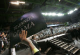 Robyn Medina (cq), 16, holds up an Obama campaign sign inside the American Bank Center Arena in...