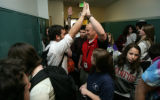 As school ended for the day, in the crowded hallway basketball player Sam Litvak, Sr. high fives...