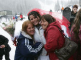 Carrie Metcalf (cq), left, and aunt Dana Metcalf, right, hug Angelina Metcalf, center, after...