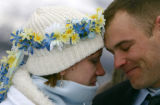Robin and Wayne Smeal, of Cleveland, have a quiet moment as they are married at the 17th annual...