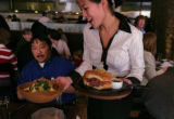 Susi Kim serves up lunch to Gerald Shibao (cq) at Second Home in Denver, Colo, Friday, February...