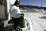 Elsie Duran, a resident at  Village at East Fork Trailer Park in Leadville, is stocking up on...
