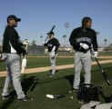 2330 Colorado Rockies top three catchers from left, Edwin Bellorin, Chris Iannetta, and Yorvit...