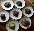 A variety of teas, clockwise from lower right, Jasmine Pearl, Mei Lu, Gingseng Oolng, Silver...