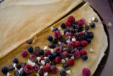Raspberries, blueberries, white and milk chocolate chips on a  crepe at Crepes a la Carte is a...