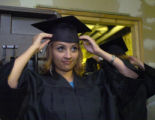 Crystal Manzanares adjusts her mortarboard before the  ceremony for 2005 GED graduates of the...
