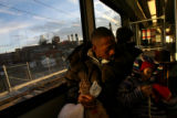 MJM239  Kelvin Hardemon (cq) rides a light rail train to the Broadway station with his daughter,...