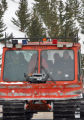 A snowcat carrying  rescued snowmobilers drives  out of the forest after  Bill Hill (cq), his...