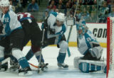 (DENVER, COLO.,  April 28, 2004)  Colorado Avalanche's #22, Steve Konowalchuk, center, gets turned...