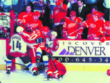 Kris Draper of the Detroit Redwings lays crumpled on the ice after being smashed face-first into...