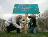 BG0085 Glenn Spagnuolo, 37, CQ, left, puts a sign in the grass at Civic Center park as a coalition...
