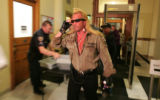 """Dog the Bounty Hunter Chapman passes through security at the State Capitol Wednesday..."