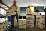 Twenty two boxes are unloaded at the election commission in Denver, Colo. on Thursday April 9,...