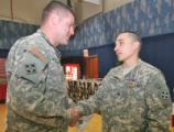 L to R Sgt John Josendale (cq) shakes hands with Army  Sgt. David Duran (cq)  after Duran and SPC...