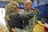Carol Graham (cq) wife of Commanding General MG Mark Graham (cq) hugs Army  SPC Michael Duer after...