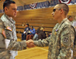 L to R: Captain Anthony Plana (cq) shakes hands with Sgt David Duran (cq) after Army  Sgt. David...