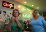 DM0088  Annie's Cafe owners Peggy Anderson, left, and Diane Williams can hardly hold back their...