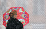 Norma Solomon (cq) waits in the snow for the bus near 8th and Downing in Denver, Colo., on...