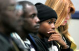 Kimine Bessard (cq) from Denver, a student of HOPE Online, listens at a Colorado Department of...
