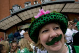 DM0258   North Dakota fan Dawn Stoe of Grand Forks N.D. sports a green mustache at Brooklyn's...