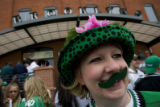 DM0262   North Dakota fan Dawn Stoe of Grand Forks N.D. sports a green mustache at Brooklyn's...