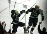 DM2363   Notre Dame's Dan Kissel celebrates with teammate Kevin Deeth, left, after Deeth's goal in...