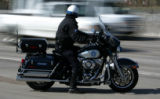A Denver Motorcycle Police officer waits to pull over a speeder  on northbound I-25 at Belleview...