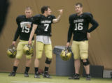BG0449 University of Colorado quarterbacks Cody Hawkins, center helps Matt Ballenger, right,...
