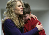 Wife Annette Tillemann-Dick hugs her son Zenith Tillemann-Dick, 11, right after speaking to the...