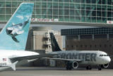 Frontier planes taxi out of concourse A at DIA Wednesday April 11, 2008. Frontier filed for...