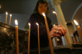 Maria Vasilas (cq), a member of the Greek Orthodox Cathedral church for 40 years, arranges candles...