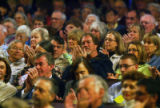 Conference on World Affairs attendees applaud opening remarks at  Macky Auditorium on the CU...
