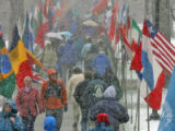 Conference on World Affairs attendees march towards Macky Auditorium on the CU campus Monday April...