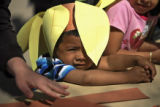 DM0438  Bryan Elizalde, 3, peers out from underneath his Denver Daisy hat that he made during the...