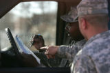 Colorado National Guard Sgts. Moore left and Sanchez right plan strategy and mapping as they go...