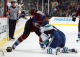 DM0285   Colorado Avalanche Ian Laperriere drags Vancouver Canucks Jeff Cowan to the ice as the...